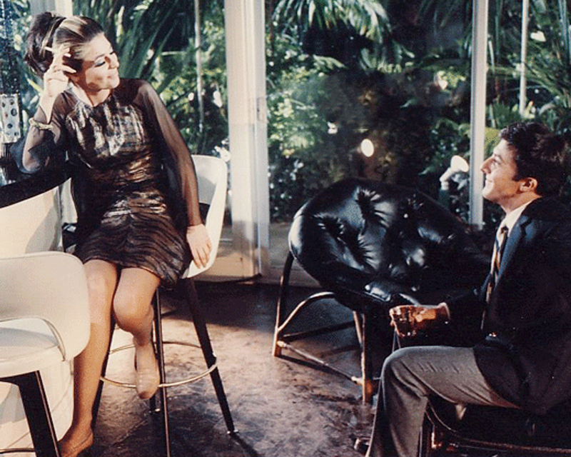 Mrs Robinson, played by Anne Bancroft, fitted out in a tiger print dress, while first seducing her prey, the much younger Benjamin Braddock (Dustin Hoffman).